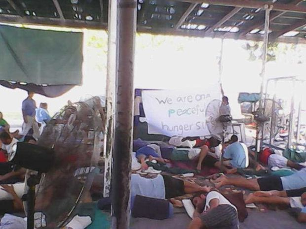 Supplied image obtained Sunday, Jan. 18. 2015 of asylum seekers during a hunger strike at the Manus Island detention centre. About 30 asylum seekers have sewn their lips together and 500 are on a hunger strike at the Manus Island detention centre, a refugee advocacy group says.