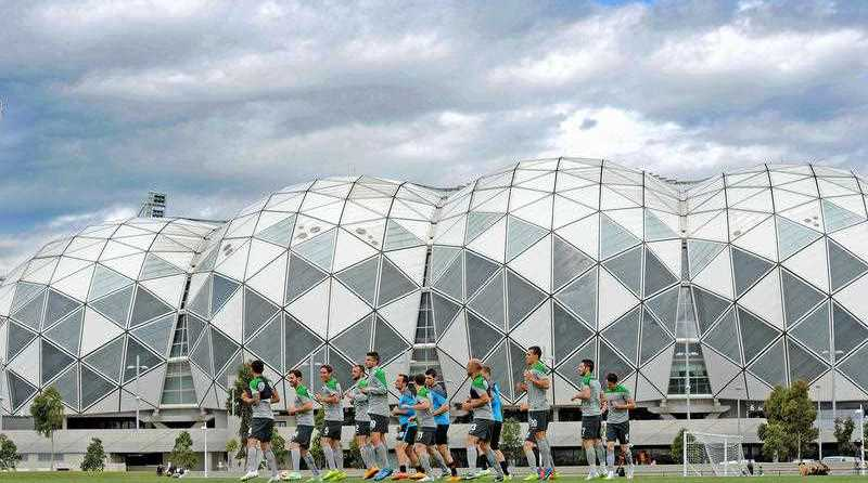 Socceroos warm up during the team training session at the Collingwood Training Centre, Olympic Park in Melbourne, Monday, Dec. 29, 2014. Australia will play Kuwait in the tournament opening match in Melbourne in 11 days.