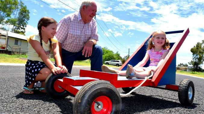 READY SET GO-KART: Hannah and Faith Waldron are excited to give the billy carts a go at Australia Day celebrations. The carts have been designed and built by Alex Waldron and the Roma Men's Shed.