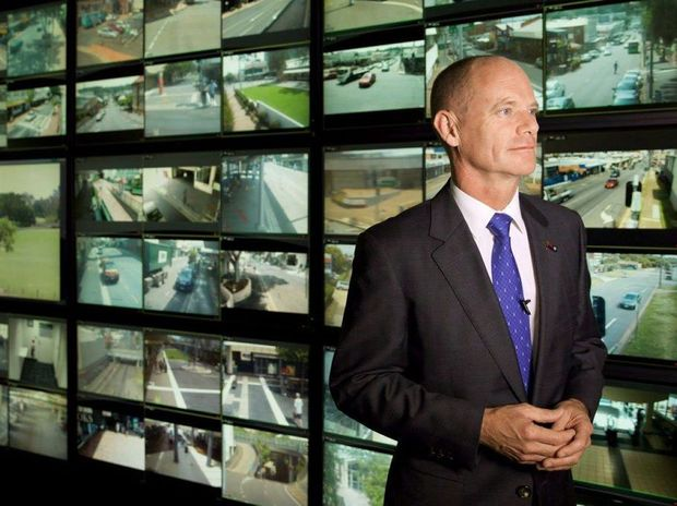 CRIME CRACKDOWN: Premier Campbell Newman looking over the Safe City headquarters yesterday.