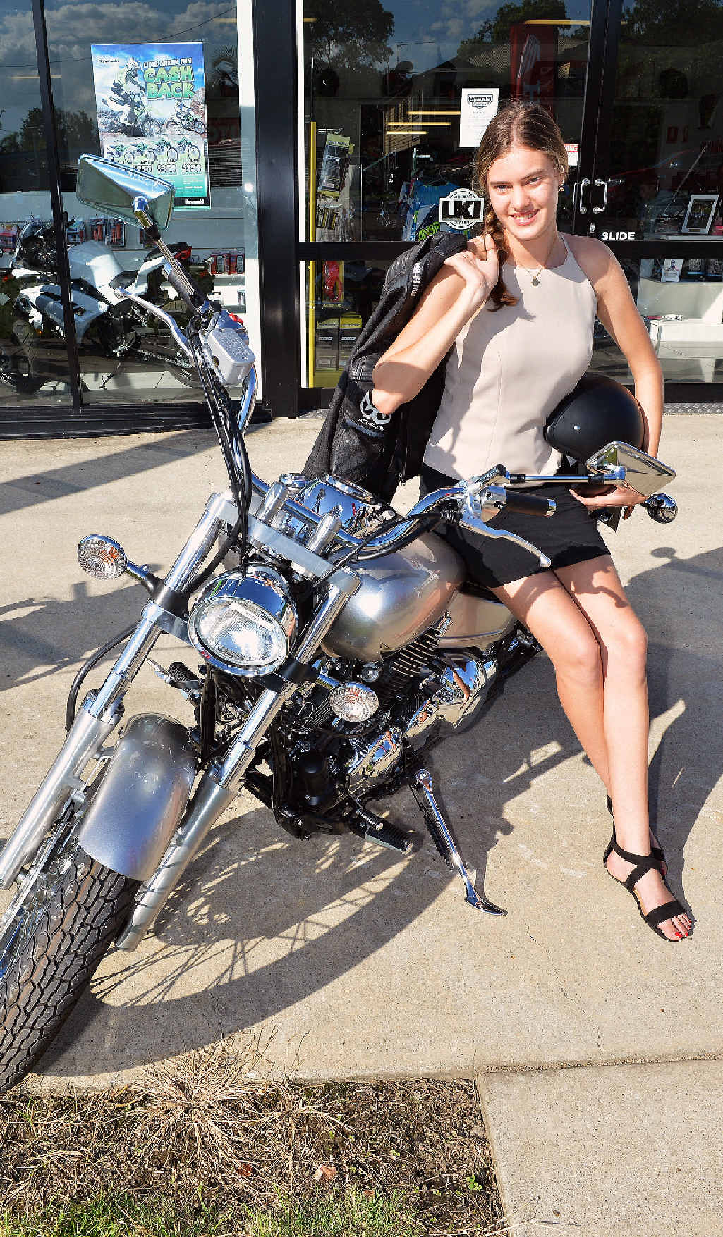 STUNNING: Chloe Walker of Carters Ridge is wooed by the Yamaha V Star 650 cc road bike at Gympie Motorcycles. It's Yamaha's highest selling bike of its type in Australia.