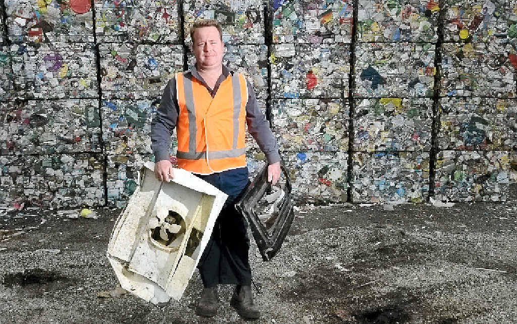 CHECK IT: Lismore Material Recycling Facility commercial services co-ordinator Kevin Trustum is pleading with residents to be mindful of the waste they throw in the recycling bins.