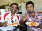 Balaji Somasundarum and Parthiban Chandrabalan enjoy a meal at the Harmony T20 cricket finals at Baxter Oval.