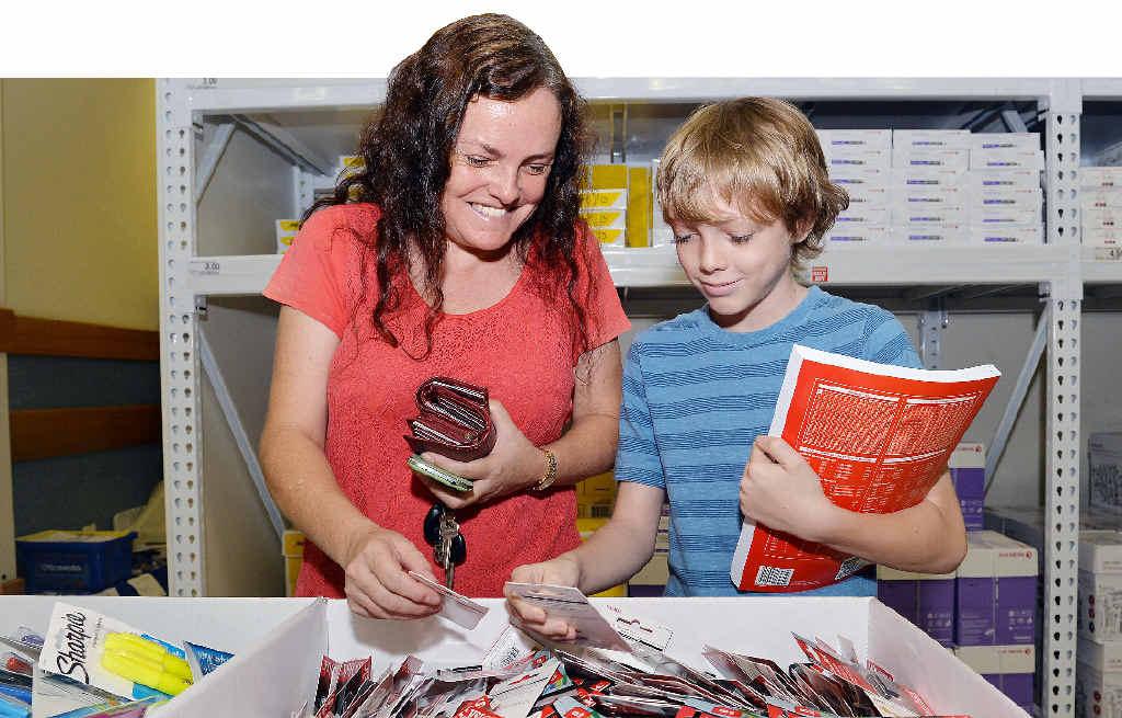 Desire Springorum and her son Wesley Springorum choose back-to-school necessities at Officeworks.