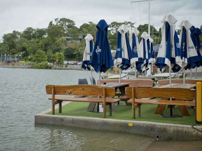 High tides roll into Gladstone at the yacht club.
