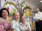 Artist Anna Bartlett and patient Alice Iverson with Coles employees Andrea Newell and Jim Lee enjoy the new mural at the Toowoomba Hospital.