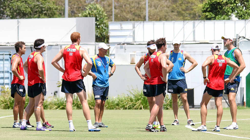 NEAFL Gold Coast Suns coach Josh Fraser (in the green vest)