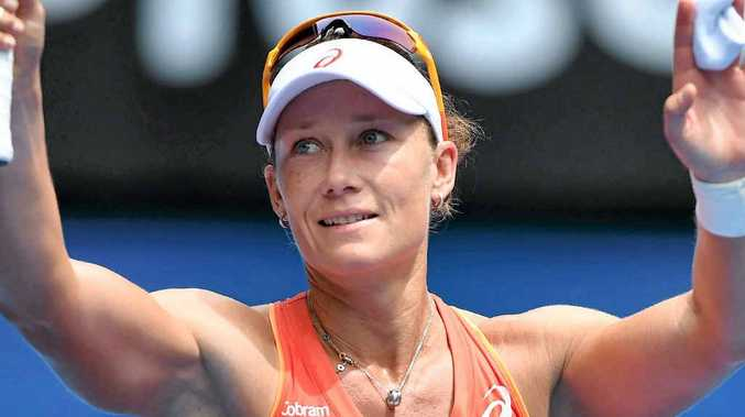 Australia's Samantha Stosur waves to the crowd after beating Monica Niculescu yesterday.