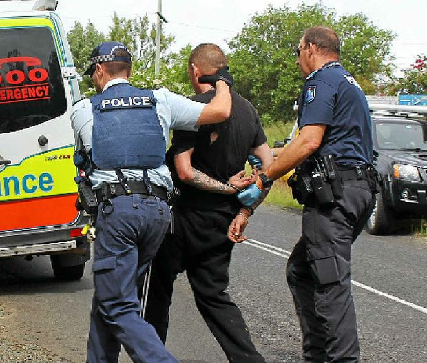 WANTED MAN: Police arrest Shane Ruben Davis after a dramatic car chase through the Lockyer Valley in April.