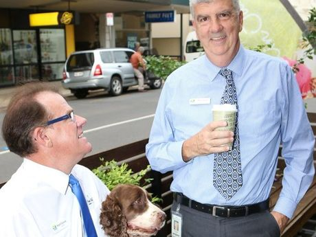 Councillors Robert Garland and Phil Truscott enjoy a coffee at Toast in Maryborough with Paris the English springer spaniel.