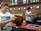 One Nation party leader Pauline Hanson stops in for a trim with hairdresser Cheryl Murray at Barber Al's on Kent St in Maryborough.