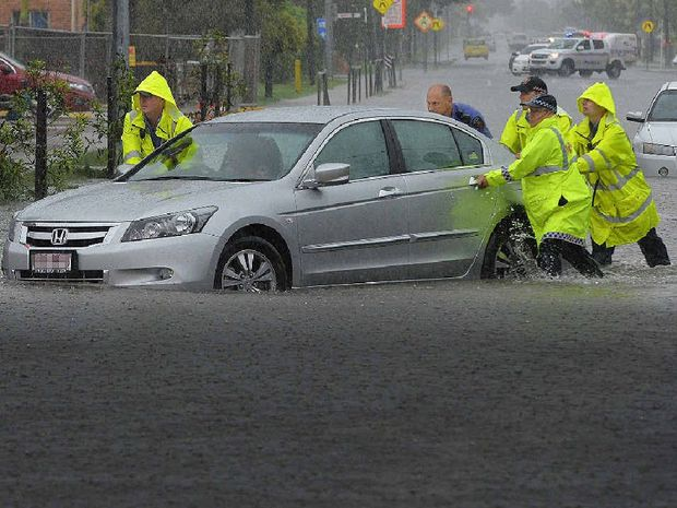 Cars stuck on Bridge Rd, Mackay as heavy rain falls on region.