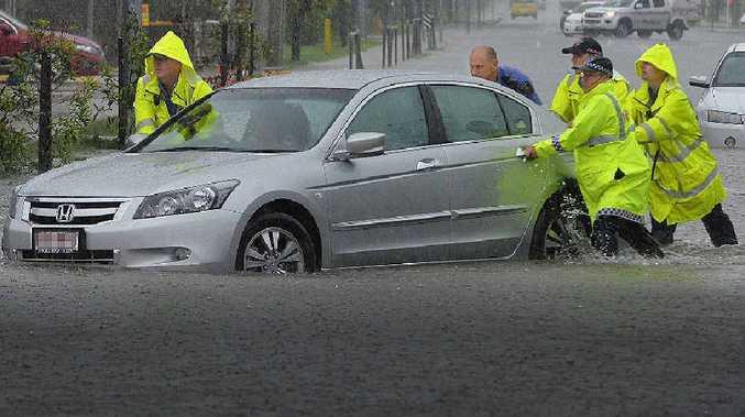 Cars stuck on Bridge Rd, Mackay as heavy rain falls on region.