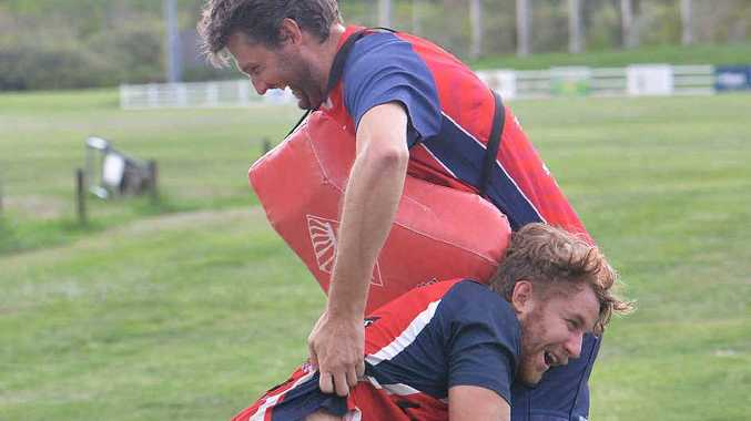FITNESS FOCUS: Byron McMahon takes his training seriously as he takes care of Chris Martin at Mackay CIty Redmen rugby training.