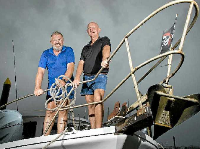 STORM WATCH: Ian Macintosh and Mark Dempster took their boats from the Boyne River to the Gladstone Marina on Wednesday.
