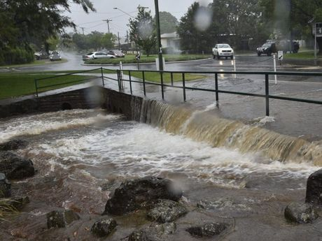 Police are urging caution as heavy rain causes minor flooding in parts of Toowoomba.