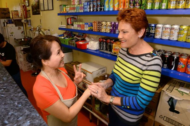 HOME TURF: Pauline Hanson with Marsden's Seafood owner Thanh Huynh on her return to the store.