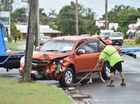 Workers clean up after a crash at the corner of Nissen St and Islander Rd in Pialba.