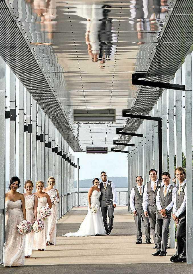 MARINA MOMENT: Chloe Clayton and Jon Donald were married in a seaside ceremony at Gladstone Marina on January 3.