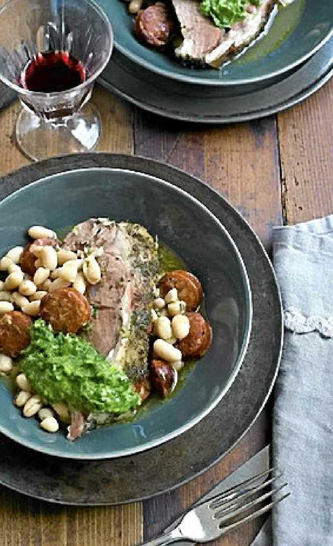 Slow-cooked lamb shoulder with chorizo and white beans.