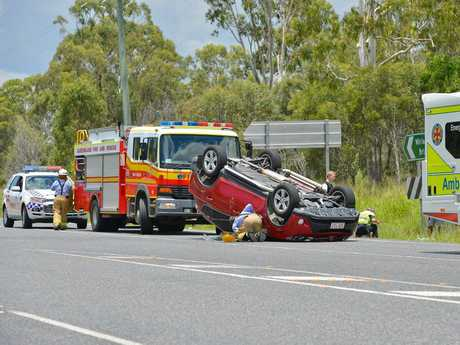 Five people have walked away after their car rolled over on the Bruce Hwy at noon on Saturday.