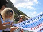 PROTECTING THE REEF: Laureeth Craig and Ginny Gerlach fly the KAFDA flag.
