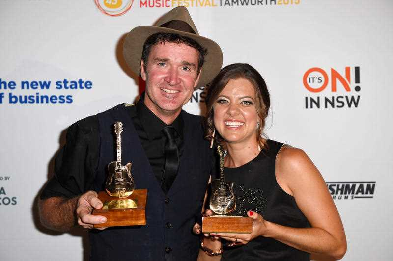 Luke O'Shea and Amber Lawrence pose for a photograph after winning the Golden Guitar for Male and Female Artist of the Year respectively, at the Golden Guitar Awards during the 43rd Tamworth Country Music Festival in Tamworth, New South Wales, Saturday, Jan. 24, 2015.