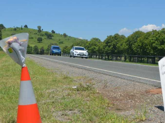 Flowers mark the spot of a fatal hit and run near Lowood in the early hours of Saturday morning.