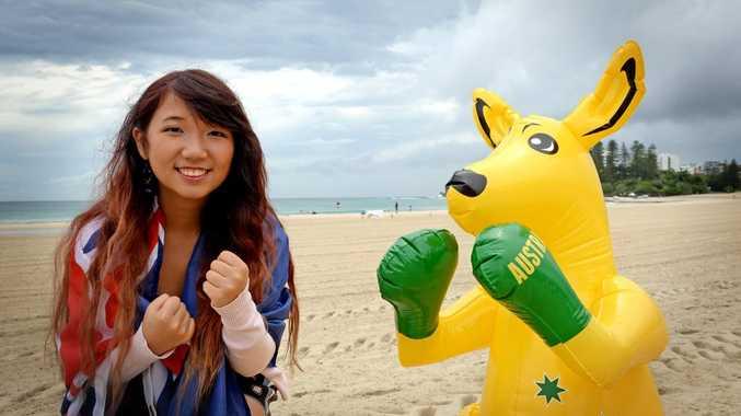 Sarah Holmes with Skippy the kangaroo on Coolangatta Beach. Photo: Blainey Woodham/ Tweed Daily News