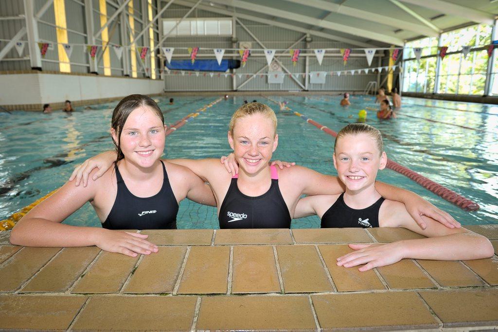 Alyssia Hampson, 11, Jessie Holmes, 11, and Tia Crosisca, 11, at the Harbour City Swim Meet.