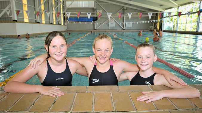 Alyssia Hampson, 11, Jessie Holmes, 11, and Tia Crosisca, 11, at the Harbour City Swim Meet.