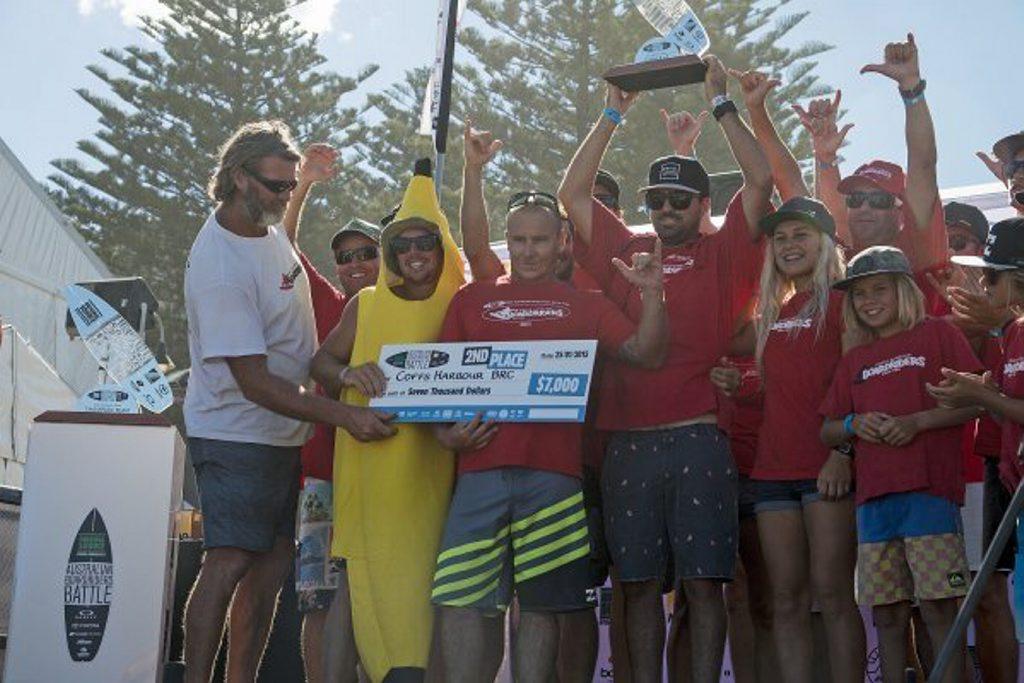 The Coffs Harbour Boardriders team celebrates finishing second overall at the Original Source Australian Boardriders Battle held at Cronulla.
