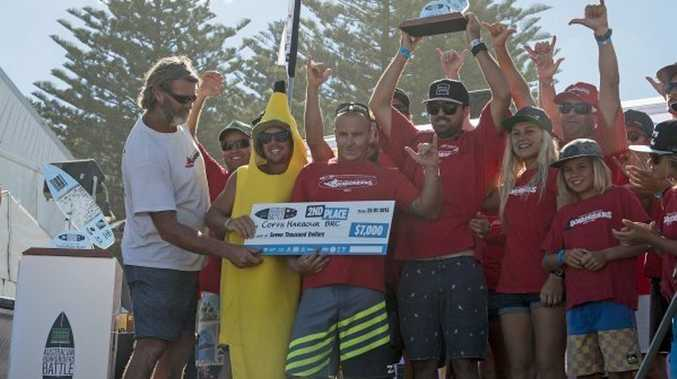 The Coffs Harbour Boardriders team celebrates finishing second overall at the Original Source Australian Boardriders Battle held at Cronulla.