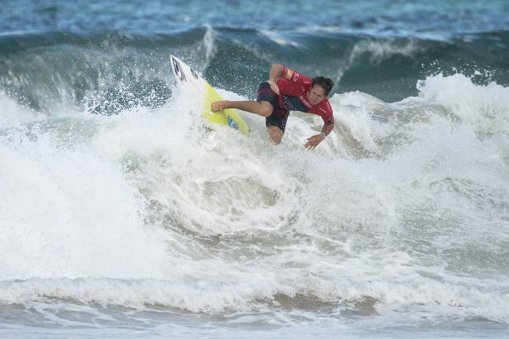 Coffs Harbour Boardriders member Shaun Cansdell attacks the Cronulla surf during the Original Source Australian Boardriders Battle.