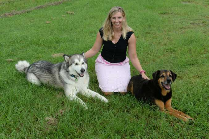 ANIMAL WELFARE: Shuron Billman with her two dogs Inu and Georgie. Shuron is conducting research on the effect of the floods on pets. Photo: Mike Knott / NewsMail