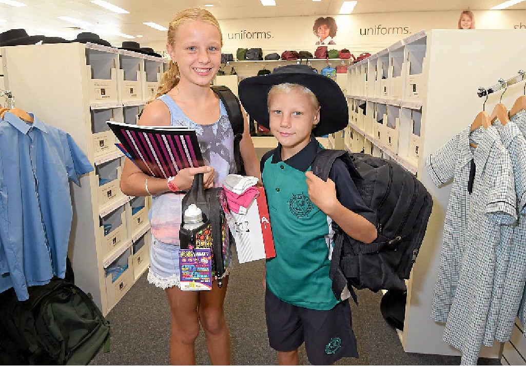 Danielle, 11, and Chris Calder, 8, pick up some last minute school supplies at School Locker.