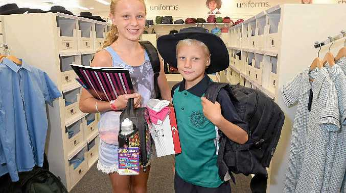 Danielle, 11, and Chris Calder, 8, pick up some last minute school supplies at School Locker.