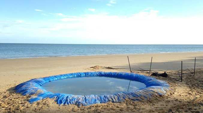 This makeshift beach pool left behind on Shelly Beach after Australia Day celebrations had to be removed by a cleaning contractor.