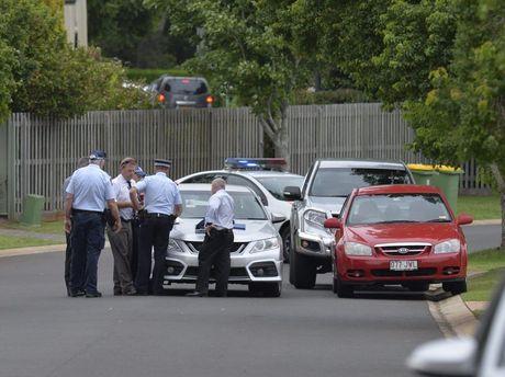 Police in a locked down Kearneys Spring St.
