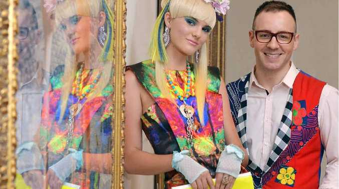 COLOURFUL: Designer Jason Chetcuti and model Cheyenne Twidale display a dress from Mr Chetcuti's latest collection, a collaboration with artist Terry Madden.