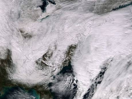 A satellite photograph shows a major winter storm bringing snow to the Northeast of the US