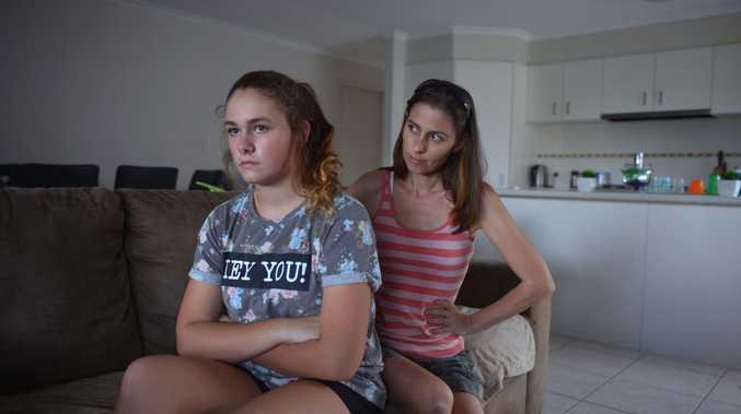Hannah Mears, 14 with a burn from salt and ice and the stare of her mother, Rebecca Etherington. Photo: John McCutcheon / Sunshine Coast Daily