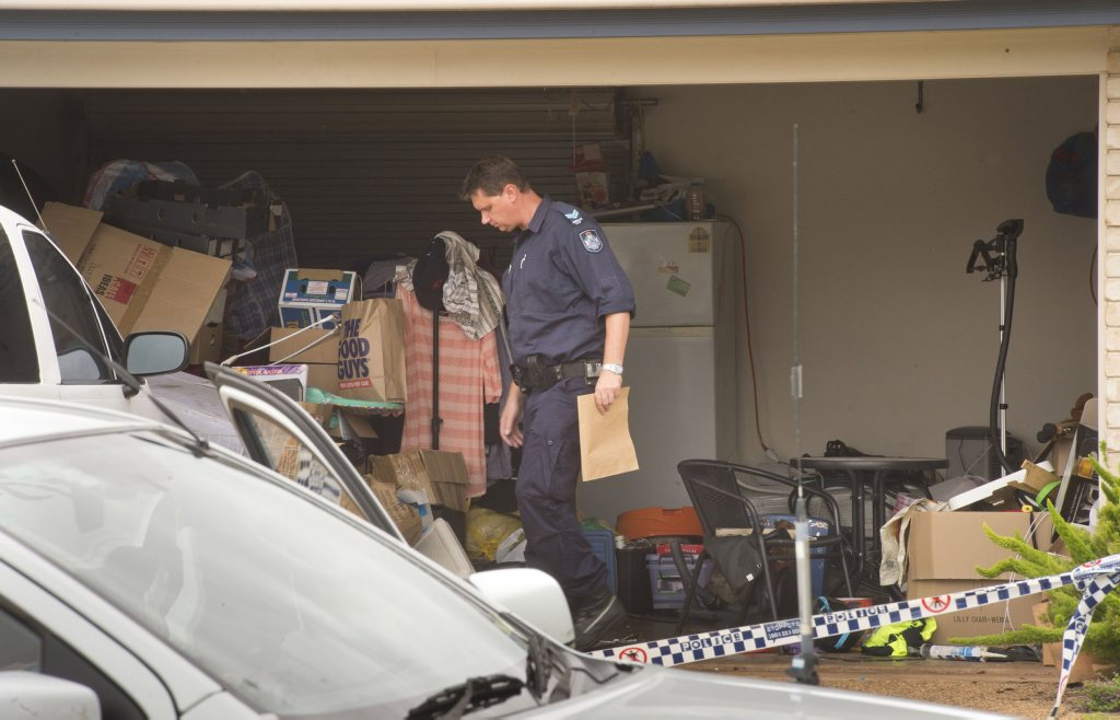 Police search a van and items at a Gouldson Drive residence connected to a charge of obtaining bomb making chemicals . Wednesday, Jan 28, 2015 . Photo Nev Madsen / The Chronicle