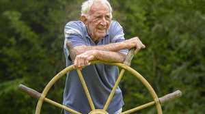 HISTORIC TREASURE: Cyril Jones, of Gilletts Ridge, with the steering wheel from the Induna. Photo: Adam Hourigan