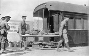 A Turkish prisoner of war, wounded in the unsuccessful attack on the Suez Canal in early February 1915, is removed from a hospital train by Australian medical orderlies at Cairo. Courtesy of Australian War Memorial C03460