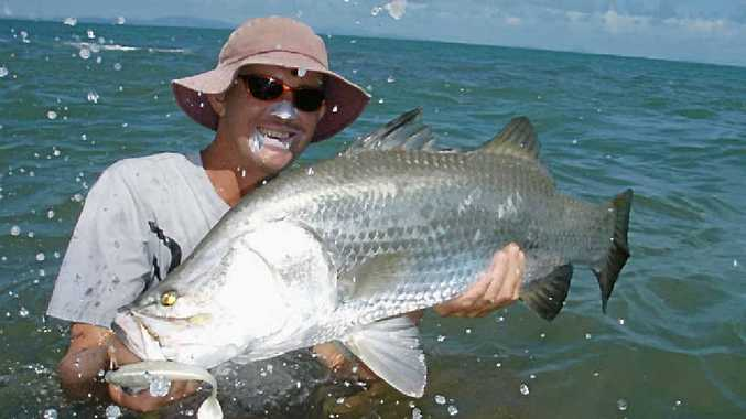 Johnny Mitchell with a nice barramundi, which will be back in season starting midday Sunday.