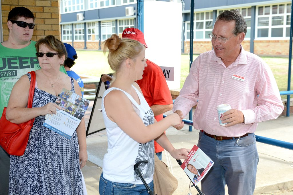 Polling Booths on Election day: Labour candidate Jim Madden talks to voters at Ipswich State High.