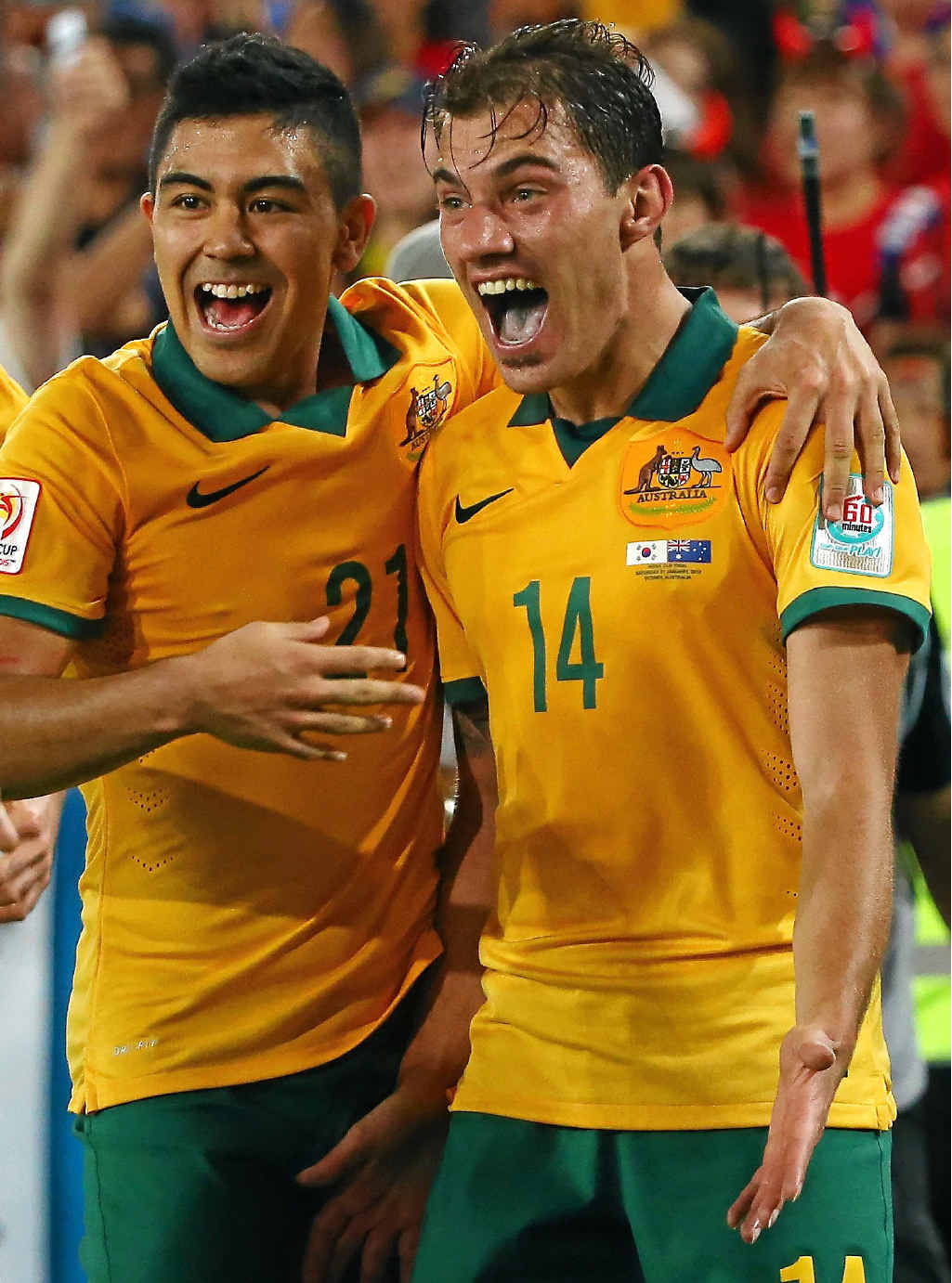 Australia's James Troisi, right, celebrates with teammates after scoring in last night's Asian Cup final.