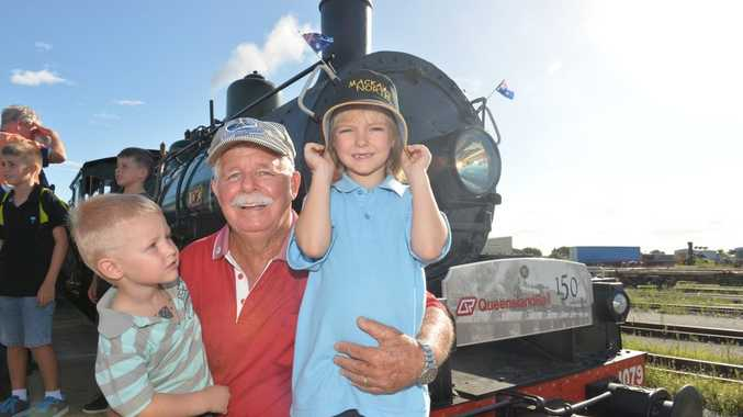 Former QRail worker Barry Nipperess with Ryan 3, and Emily Hazelwood came to see the steam train come into Mackay.