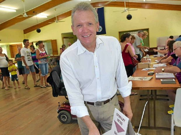 HIGH HOPES: Member for Caloundra, Mark McArdle, casts his vote at the CCSA Hall in Nutley Street, Caloundra.